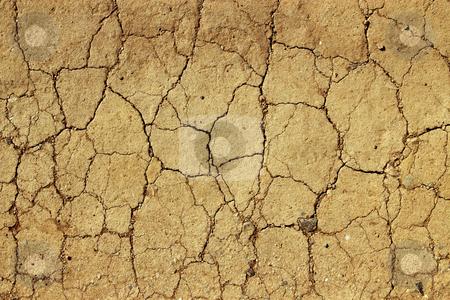 Dry cracked mud close up natural abstract background. stock photo, Dry cracked mud close up natural abstract background. by Stephen Rees