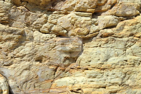 Cliff rock face being eroded by the sea. stock photo, Cliff rock face being eroded by the sea. by Stephen Rees