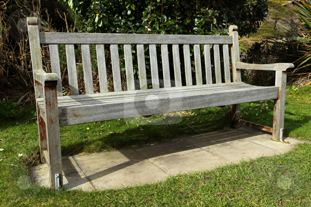 An old wooden park bench. stock photo, An old wooden park bench. by Stephen Rees