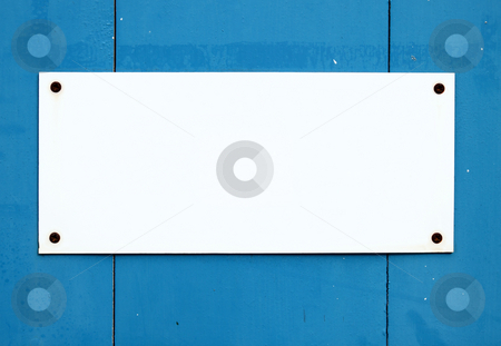 Blank white sign on a blue door. stock photo, Blank white sign on a blue door. by Stephen Rees