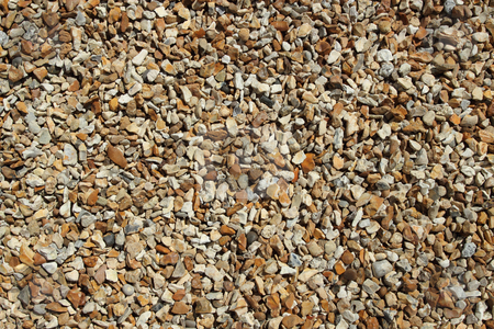 Lots of small brown colors beach stones. stock photo, Lots of small brown colors beach stones. by Stephen Rees