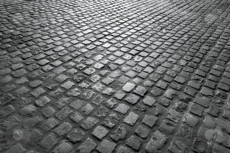 Old English cobblestone road close up in black and white. stock photo, Old English cobblestone road close up in black and white. by Stephen Rees