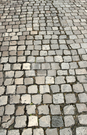 Old English cobbles road close up. stock photo, Old English cobbles road close up. by Stephen Rees