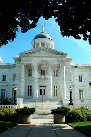 Old courthouse with blue sky stock photo, A Old courthouse with blue sky by Jim Mills
