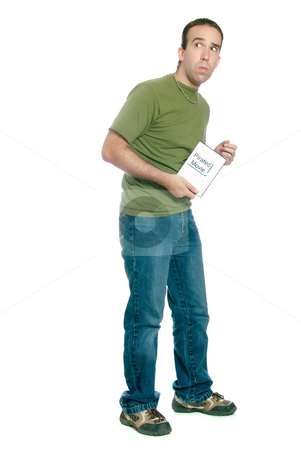 Illegal Movie Download stock photo, A young man sneaking away with an illegal movie download, isolated against a white background. by Richard Nelson