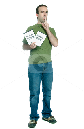 Pirated Movies and Software stock photo, Full length view of a young man holding 2 dvd cases of bootlegged movies and software, isolated against a white background. by Richard Nelson
