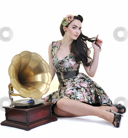Pretty girl listening music on old gramophone stock photo, Pretty girl listening music on old gramophone isolated on white in studio by Benis Arapovic