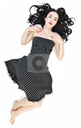 Pinup fashion  stock photo, Pretty happy young pinup girl isolated on white in studio representing old fashion concept and style by Benis Arapovic