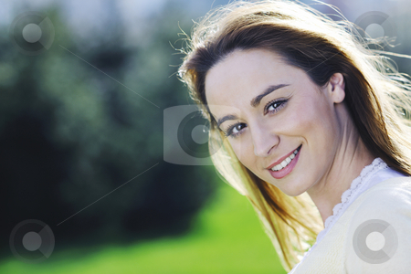 Young woman outdoor portrait stock photo, Happy young beautiful woman face closeup and portrait outdoor at sunny day by Benis Arapovic