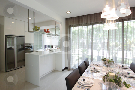 Kitchen and dining area stock photo, Interior view of a modern kitchen and dining area by Adrin Shamsudin