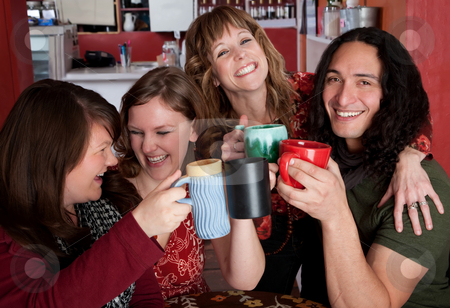 Toast stock photo, Four friends with mugs toasting at a cafe by Scott Griessel