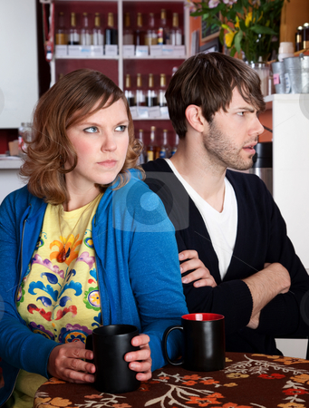 Bickering and frustrated couple  stock photo, Bickering and frustrated couple sitting with coffee at a table by Scott Griessel