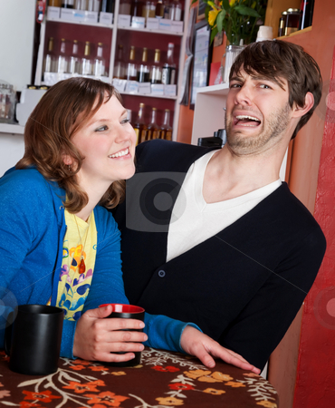 Shy man and aggressive woman stock photo, Shy man recoils from aggressive woman in a coffee house by Scott Griessel