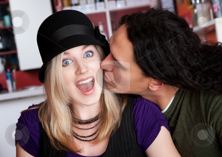 Interracial kiss alone at a cafe stock photo, Interracial kiss alone at a cafe by Scott Griessel