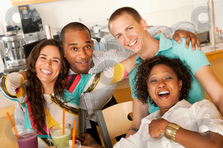 Group of Friends Laughing stock photo, A group of young friends are laughing together while smiling at the camera.  Horizontal shot. by Scott Griessel