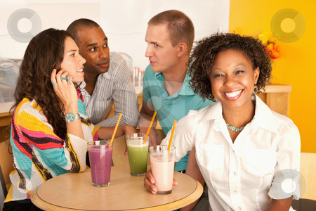 Two Couples Dining Out stock photo, Two couples at a cafe drinking frozen beverages. Horizontal shot. by Scott Griessel
