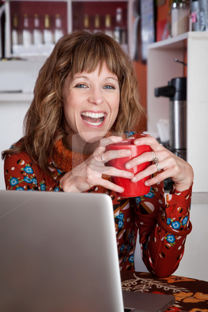 Pretty lady laughing stock photo, Pretty lady laughing with red ceramic mug at a cafe by Scott Griessel