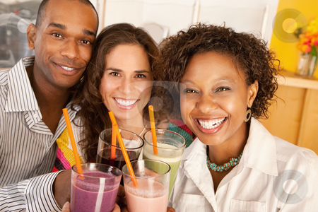 Friends Socializing Over Smoothies stock photo, A group of friends are holding smoothies and smiling at the camera.  Horizontal shot. by Scott Griessel