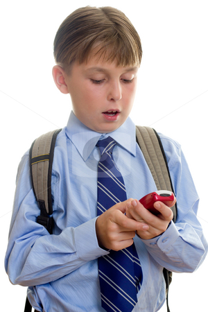School boy child sms texting stock photo, A schoolboy student using a mobile cell phone is sms or texting.  White background. by Leah-Anne Thompson