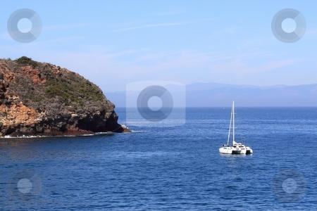 Bay Sailboat stock photo, A sailboat in a bay at Santa Cruz Island with a blue ocean by Henrik Lehnerer