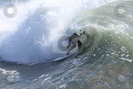 Surfer stock photo, Surfer riding a wave in the Pacific Ocean by Henrik Lehnerer