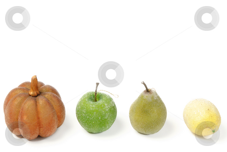 Artificial Fruit stock photo, A row of artificial fruit, pumkin, apple, pear, and lemon, isolated against a white background with copyspace on top by Richard Nelson