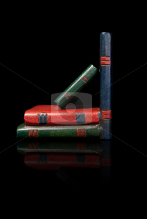 Wooden Bookend stock photo, A wooden bookend designed to look like books, isolated against a black background with a reflection by Richard Nelson