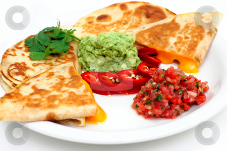 Close-up Of Quesadilla And Salsa stock photo, Cheddar cheese quesadilla's with guacamole fresh salsa and sliced red chili pepper topped with guacamole and cilantro by Lynn Bendickson