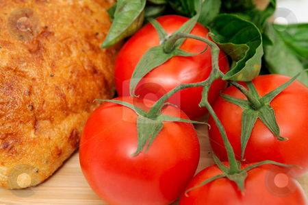 Tomatoes And Old Style Bread stock photo, Close-up of unsliced old style artisan bread  with fresh herbs and tomatoes by Lynn Bendickson