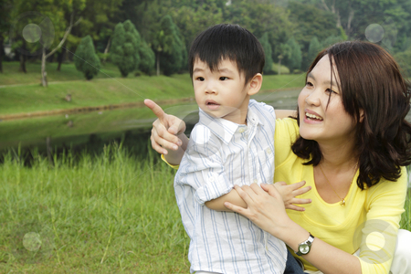 Mother and son stock photo, An Asian mother and her son at a public park by Adrin Shamsudin