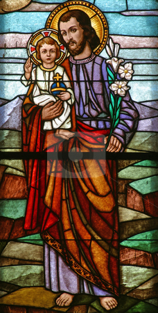 Saint Joseph holding baby Jesus stock photo, Stained glass with Saint Joseph holding baby Jesus by Zvonimir Atletic