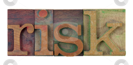Risk stock photo, The word risk in vintage wooden letterpress type blocks, stained by color ink, isolated on white by Marek Uliasz