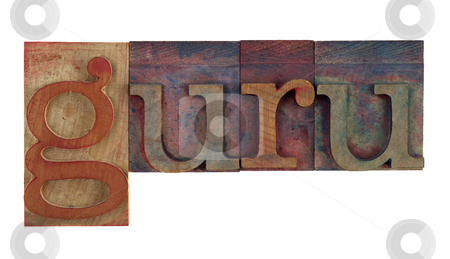 Guru stock photo, The word guru in vintage wooden letterpress type blocks, stained by color ink, isolated on white by Marek Uliasz