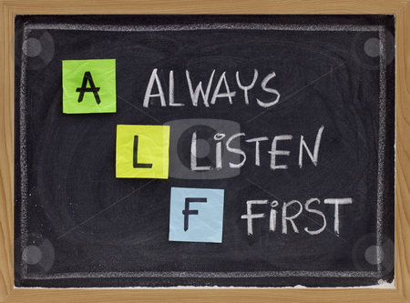 Always listen first - ALF acronym stock photo, ALF acronym (always listen first) - good advice for training, counselling, customer service, selling or relationships, sticky notes and white chalk handwriting on blackboard by Marek Uliasz