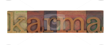 Karma stock photo, The word karma in vintage wood letterpress type blocks, stained by color ink, isoalted on white by Marek Uliasz