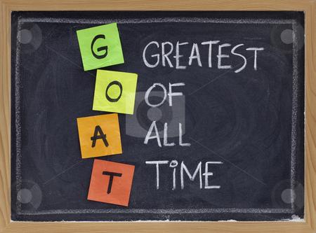 Greatest of all time - GOAT acronym stock photo, GOAT acronym (greatest of all time ) - sticky notes and white chalk handwriting on blackboard by Marek Uliasz