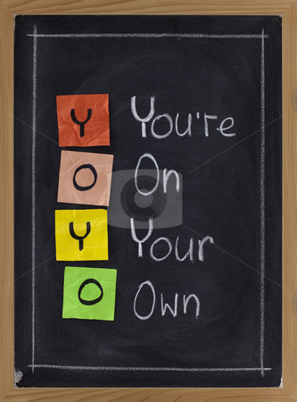 Yoyo - yoa are on your own stock photo, YOYO acronym (you are on wyour own), sticky notes and white chalk handwriting on blackboard by Marek Uliasz