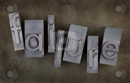 Failure concept stock photo, The word of failure in old metal letterpress type blocks on rusty and grunge background by Marek Uliasz
