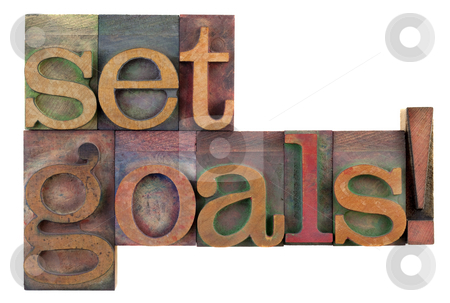 Set goals - motivational reminder stock photo, Set goals reminder in vintage wooden letterpress type blocks, stained by color ink, isolated on white by Marek Uliasz