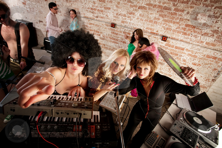 1970s Disco Music Party stock photo, Female DJs checking out the scene at a 1970s Disco Music Party by Scott Griessel