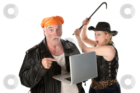Woman with crowbar threatening man with laptop computer stock photo, Woman with crowbar threatening man looking at something risque on laptop computer by Scott Griessel