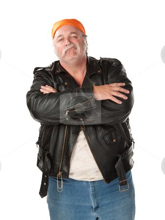 Smirking stock photo, Smirking biker gang member with leather jacket by Scott Griessel