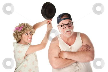 Woman swinging frying pan at husband stock photo, Woman swinging frying pan toward the head of an unsuspecting man by Scott Griessel