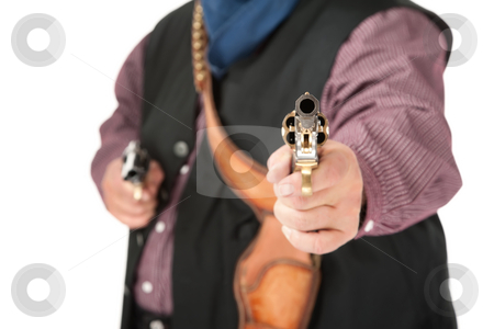 Closeup of pistol aimed at camera stock photo, Shootout with two pistols held by cowboy by Scott Griessel