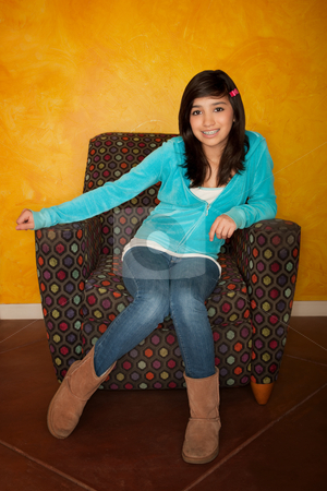 Pretty Latina Girl stock photo, Pretty Latina Girl Seated on Colorful Chair by Scott Griessel