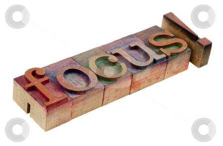 Focus stock photo, The word focus with exclamation point in vintage wooden letterpress type blocks, stained by color ink, isolated on white by Marek Uliasz
