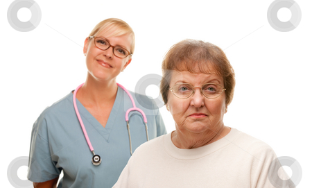 Concerned Senior Woman with Doctor Behind stock photo, Concerned Senior Woman with Female Doctor Behind Isolated on a White Background. by Andy Dean