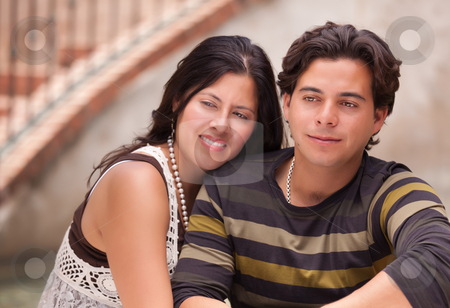 Attractive Hispanic Couple Portrait Outdoors stock photo, Attractive Hispanic Couple Portrait Enjoying Each Other Outdoors. by Andy Dean