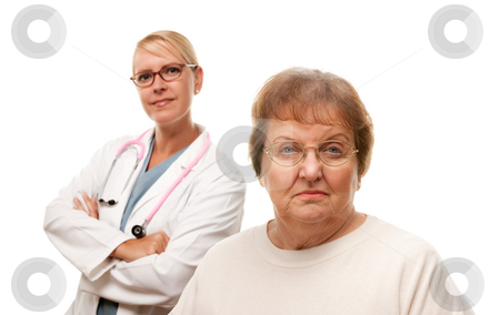 Concerned Senior Woman with Doctor Behind stock photo, Concerned Senior Woman with Doctor Behind Isolated on a White Background. by Andy Dean
