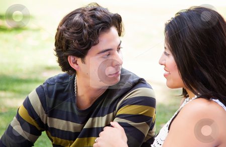 Attractive Hispanic Couple At The Park stock photo, Attractive Hispanic Couple Enjoying Themselves At The Park. by Andy Dean